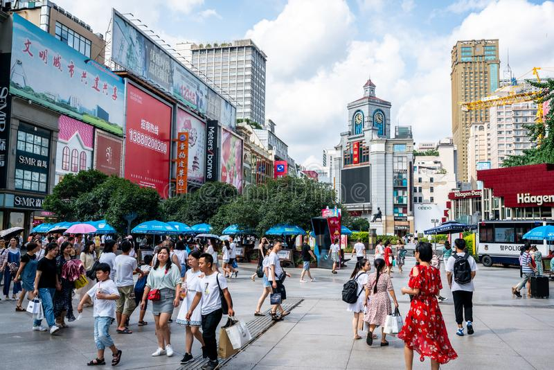 View of Chunxi road with clock tower building full of people the main shopping pedestrian street of Chengdu Sichuan China. Chengdu Sichuan China, 3 August 2019 stock image
