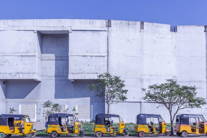 Chennai, India, 02.01.2017. Local auto rickshaw stand parked in a row outside Taramani railway station royalty free stock image