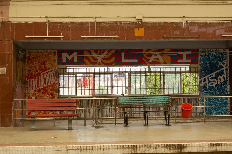 Chennai, India - September 04 2019: Scene at Thirumayilai MRTS Railway Station with wall paintings naming the place `Mylai` in 3. Languages English, Tamil stock images