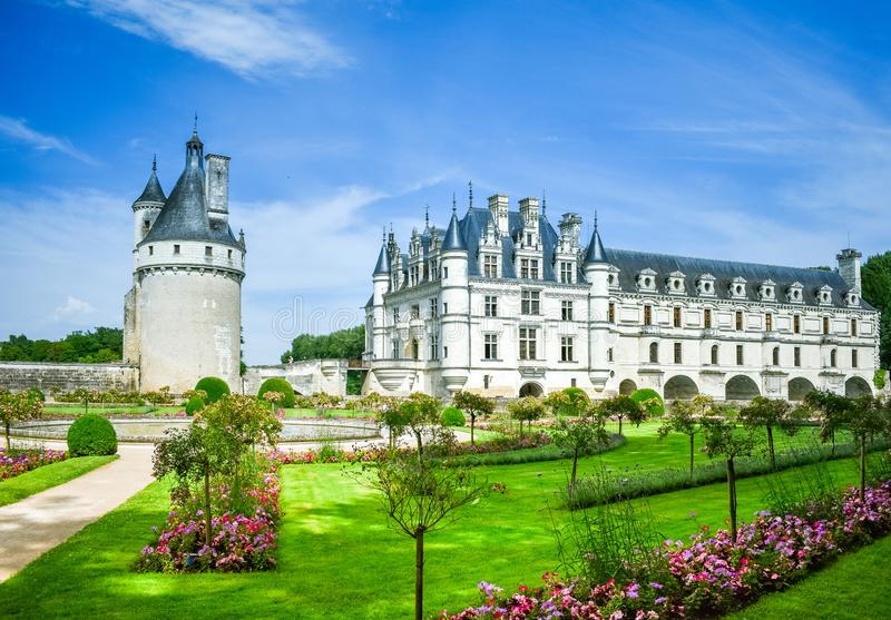 CHENONCEAU CASTLE, FRANCE - JULY 06, 2017: French loire valley castle spanning the River Cher. Garden, tower and main building, in. A summer day at Chenonceau stock photos
