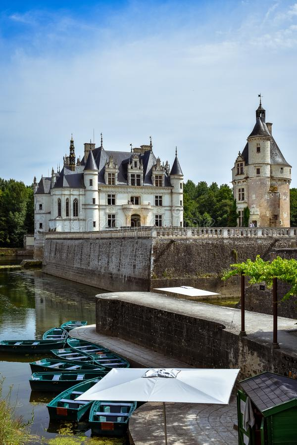 CHENONCEAU CASTLE, FRANCE - JULY 06, 2017: French loire valley castle spanning the River Cher. View from the lake in a summer day. At Chenonceau Castle, France stock images