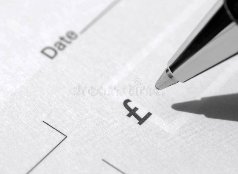 Cheque book and pen royalty free stock photo