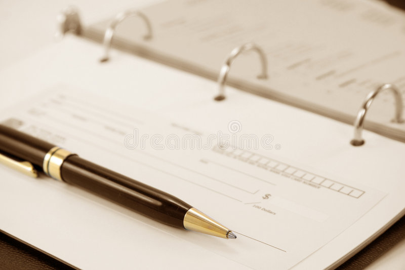 Cheque com caderno fotos de stock royalty free