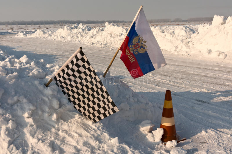Chequered flag at finish point. Chequered flag at ice-racing finish point stock image