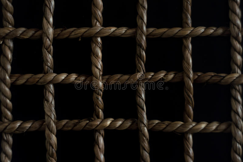 Chequered pattern with a rope.  royalty free stock photo