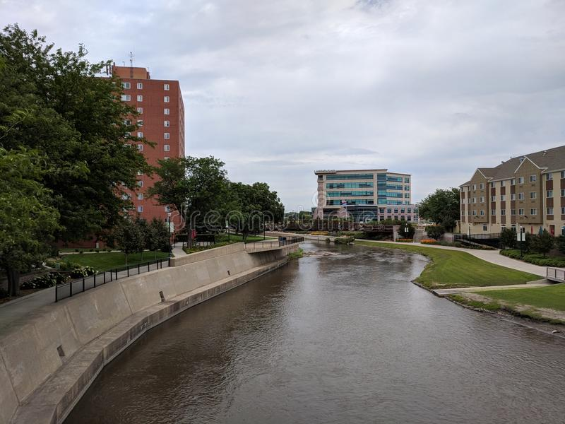 Cherapa Place on the Big Sioux River. The Big Sioux River curves to the left at Cherapa Place in downtown Sioux Falls, South Dakota stock image