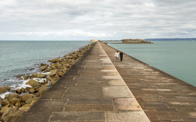 Couples stroll through fortifications dyke in the harbor of Cherbourg. Normandy, France stock photography