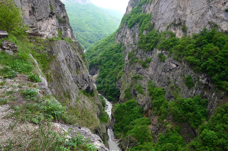 Cherek Gorge in Kabardino-Balkaria in the North Caucasus, Russia. Breathtaking view of the mountain gorge and the river from above. Steep cliffs overgrown with stock photography