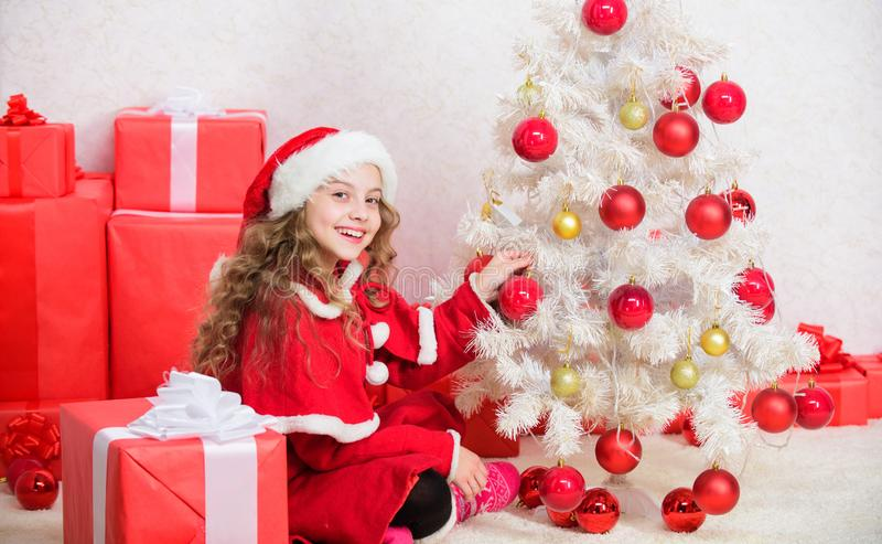 Cherished holiday activity. Child enjoy family tradition. Christmas eve concept. Join christmas celebration. Girl. Smiling adorable santa claus sit near stock images