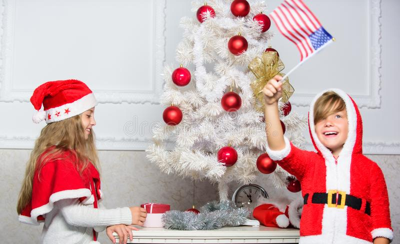 Cherished holiday activity. Kids in santa hats decorating christmas tree. Family tradition concept. Children decorating. Christmas tree together. Boy and girl royalty free stock photo