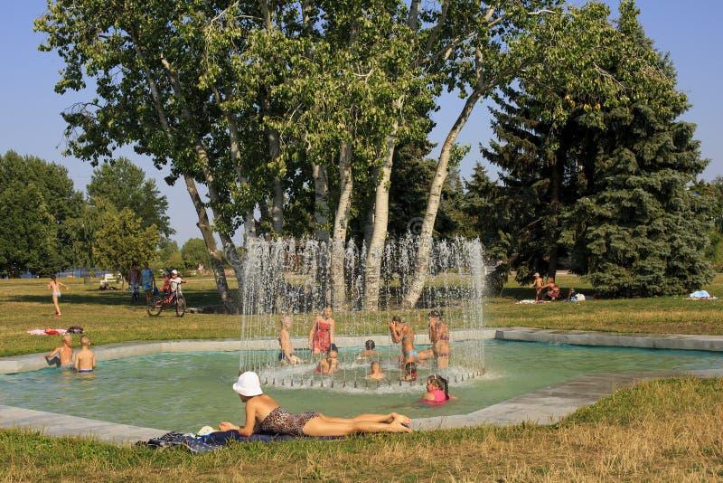 Cherkassy. Ukraine. August 4-2017 : Children bathe  in the city`s fountain in the heat royalty free stock photo
