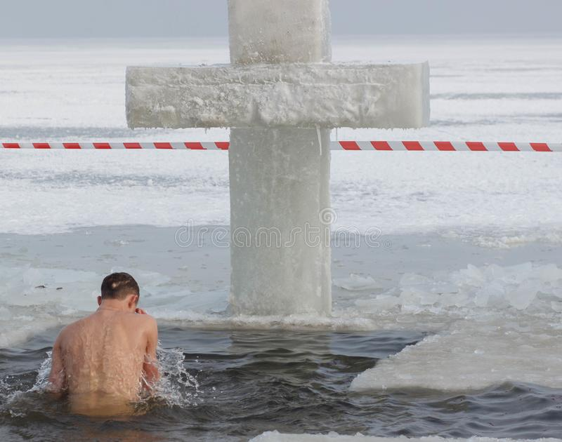 CHERKASSY, UKRAINE - January 19, 2017: Traditional ice swimming in Orthodox church Holy Epiphany Day. Ice cross and Ice-hole for bathing into sub-zero water on royalty free stock photos