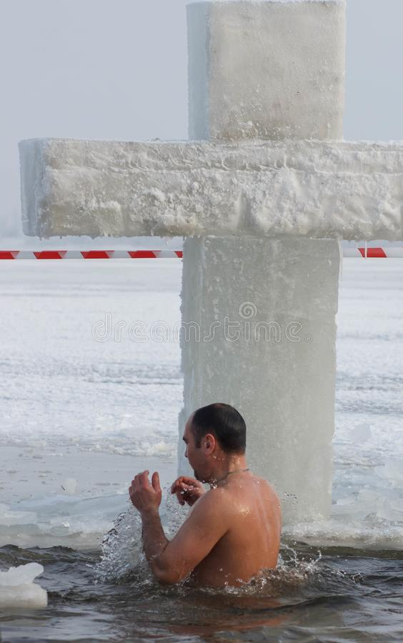 CHERKASSY, UKRAINE - January 19, 2017: Traditional ice swimming in Orthodox church Holy Epiphany Day. Ice cross and Ice-hole for bathing into sub-zero water on stock photography