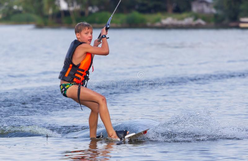 Cherkassy, Ukraine - July 19, 2019: Wakeboarder boy showing of tricks and skills at wakeboarding event in Cherkassy royalty free stock photography