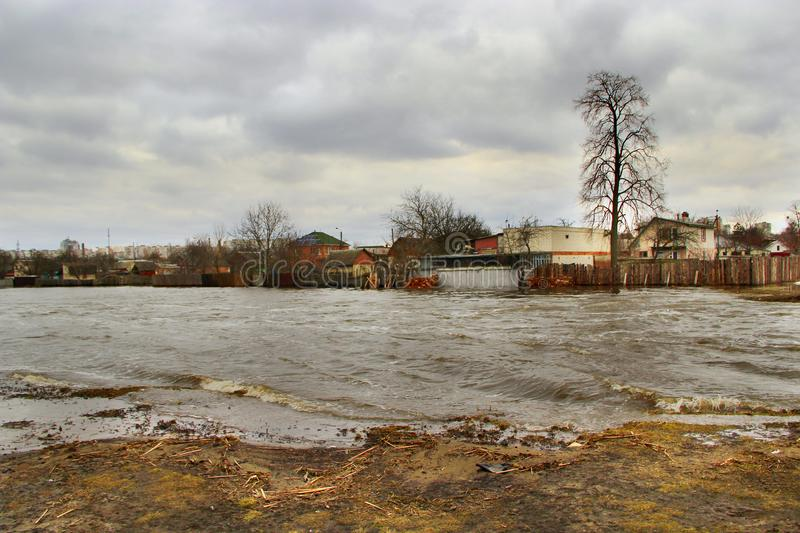 Flooding of river in spring in town during melting of snow. Natural disaster. Chernihiv / Ukraine 02 April 2018: Flooding of river in spring in town during stock images