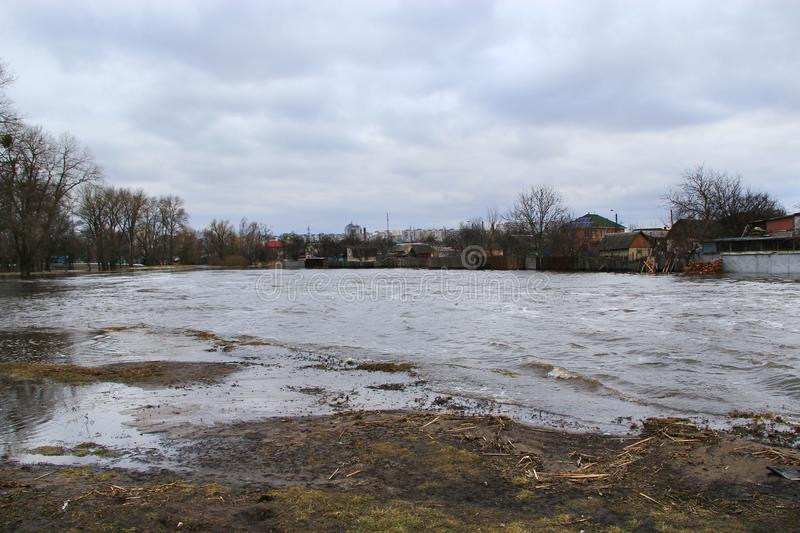 Flooding of river in spring in town during melting of snow. Natural disaster. Chernihiv / Ukraine 02 April 2018: Flooding of Stryzhen river in spring in royalty free stock photography