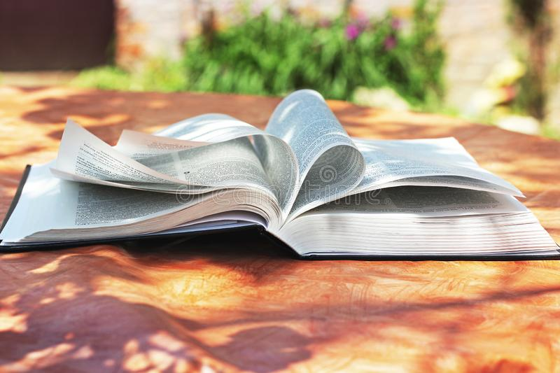 Chernihiv, Ukraine - May 27, 2019: An open Bible on the table. The book of life stock photography