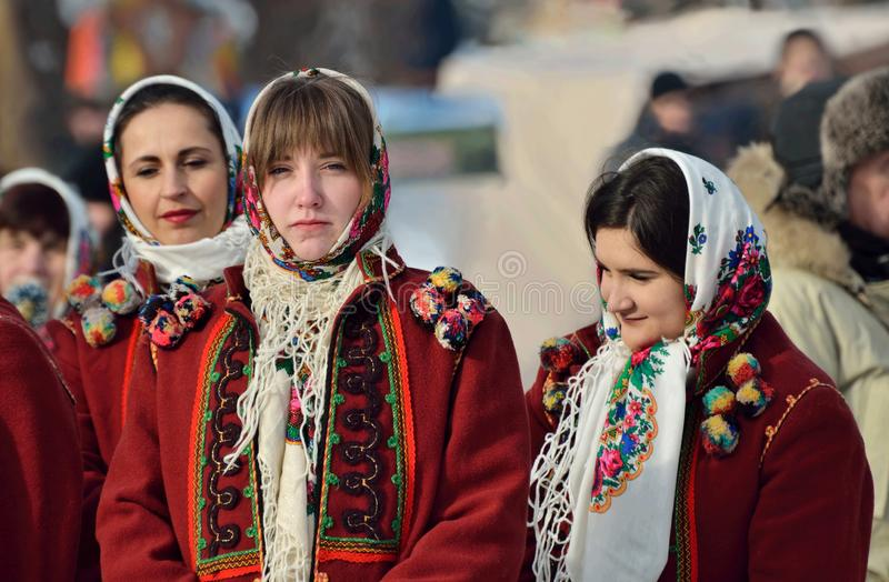 Young hucul woman performs Malanka song during ethnic festival of Christmas Carols in open-air museum of folk architecture,Ukraine royalty free stock images