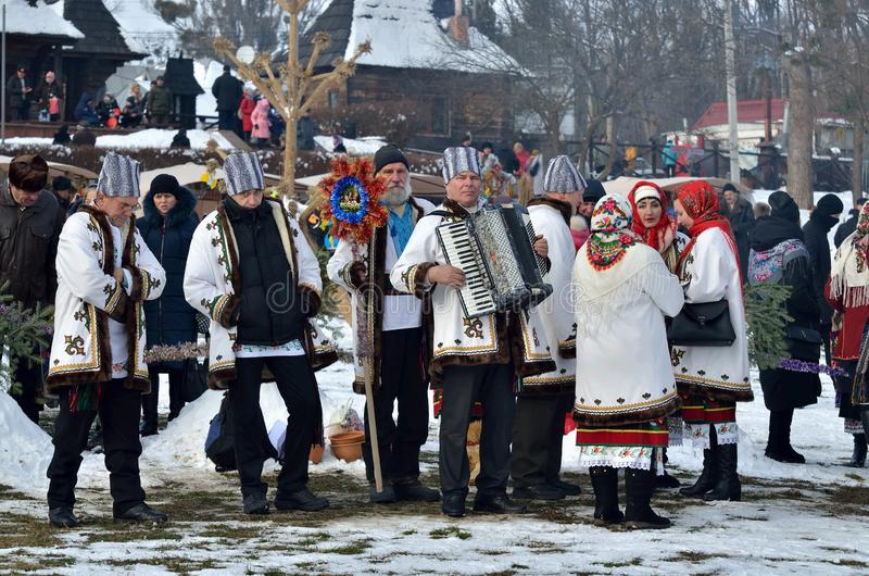 Folklore collective performs Christmas and Malanka songs during the ethnic festival of Christmas Carols in open-air museum,Ukraine stock photos