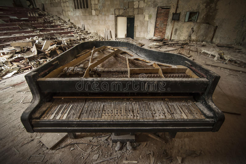 Chernobyl - close-up of an old piano in an auditorium royalty free stock photos