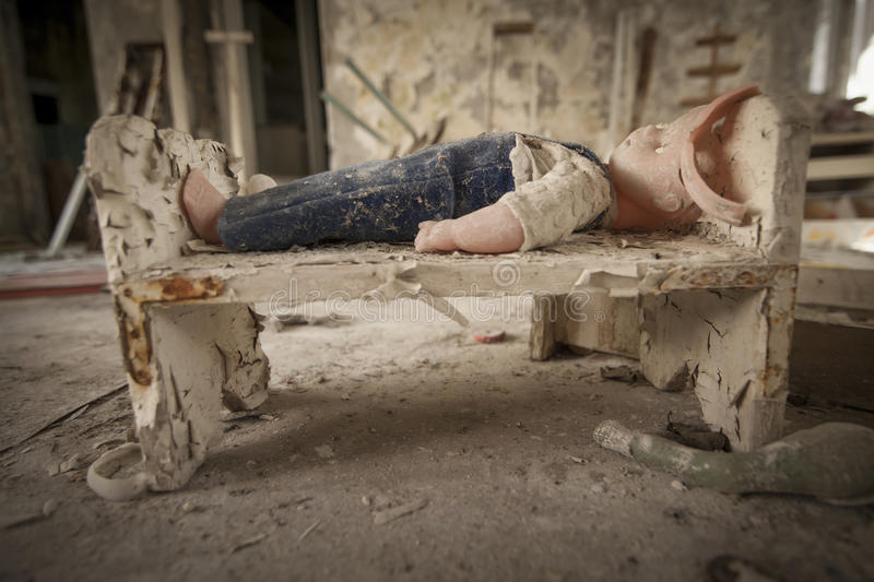 Chernobyl - Doll in a doll bed stock photos