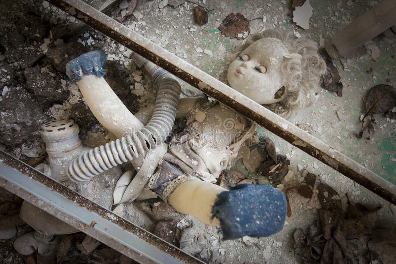 Chernobyl - Doll placed under metal beams stock photography