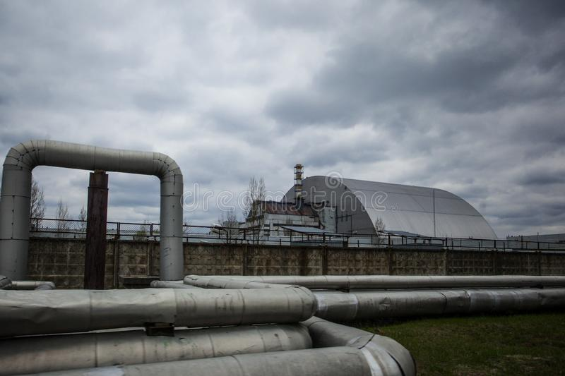 : View of the destroyed Reactor 4 and the Memorial for the Chernobyl liquidators royalty free stock photo