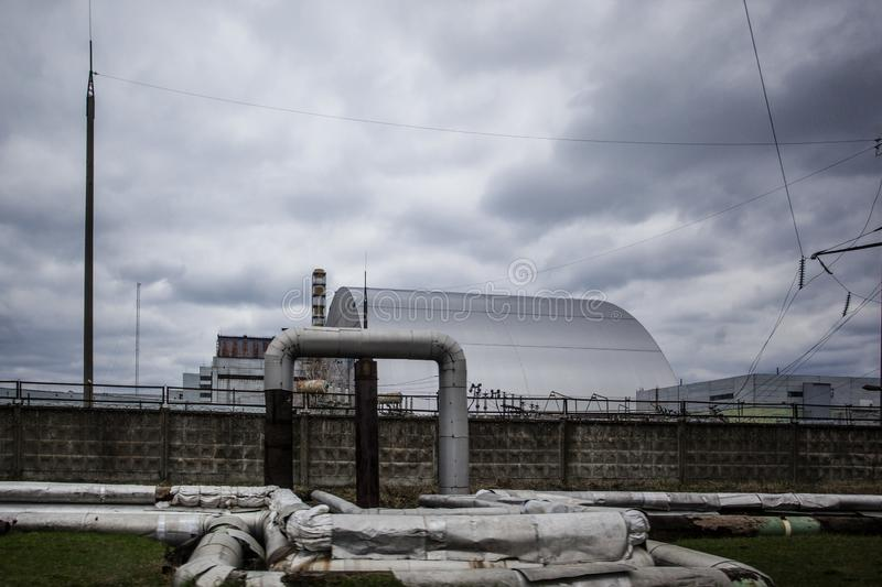 : View of the destroyed Reactor 4 and the Memorial for the Chernobyl liquidators royalty free stock images