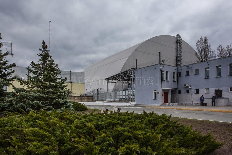 : View of the destroyed Reactor 4 and the Memorial for the Chernobyl liquidators royalty free stock photography