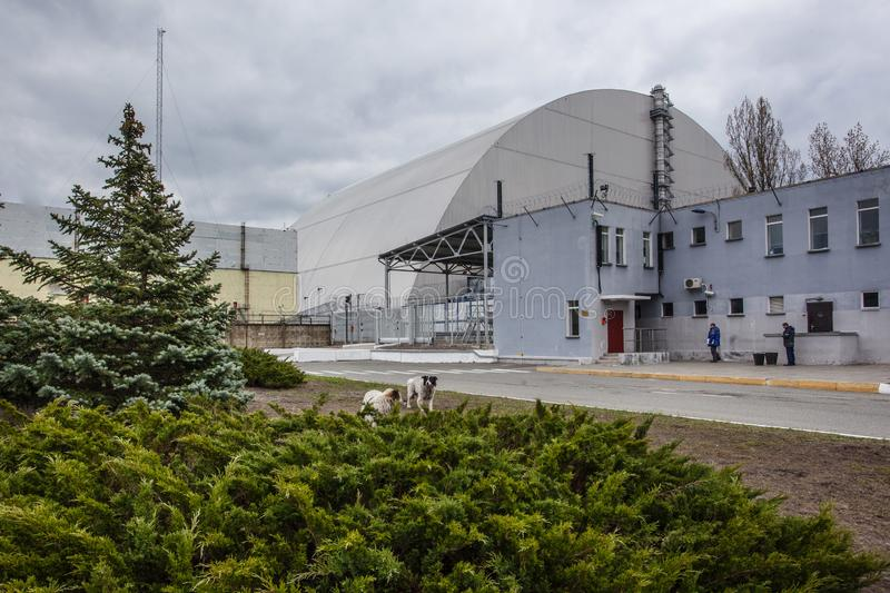 : View of the destroyed Reactor 4 and the Memorial for the Chernobyl liquidators stock photography