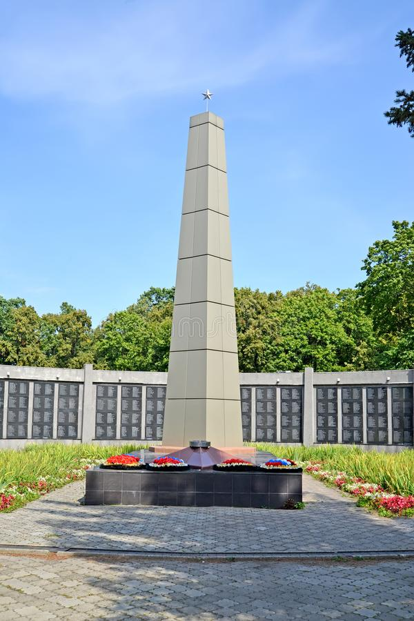 CHERNYAKHOVSK, RUSSIA. An obelisk on a mass grave of the Soviet soldiers. Kaliningrad region stock images