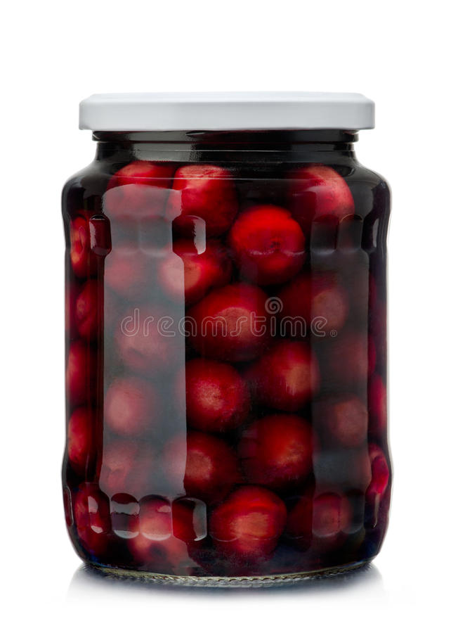 Cherries compote. Jar of cherry compote isolated on white stock photos