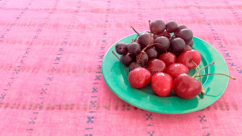 Cherries and Grapes in a Plate. Cherries and Grapes Served in a Plate royalty free stock images