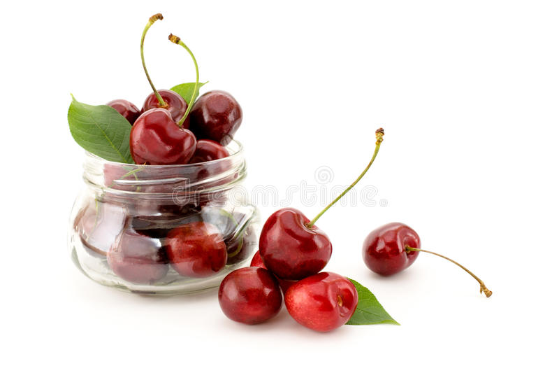 Cherries in a jar isolated royalty free stock photography