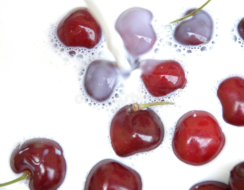 Cherries with milk stock photos