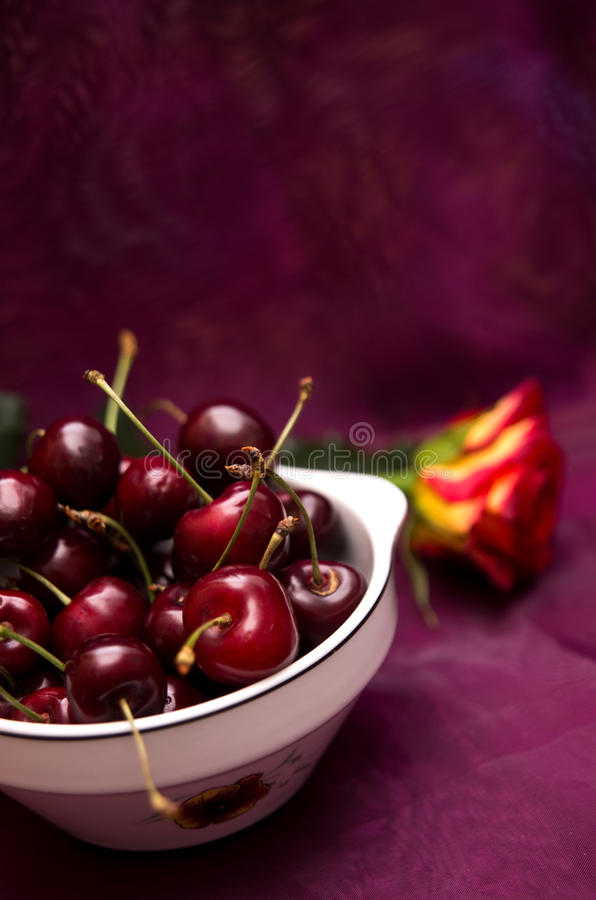Download Cherries on red stock image. Image of flower, purple - 25486685