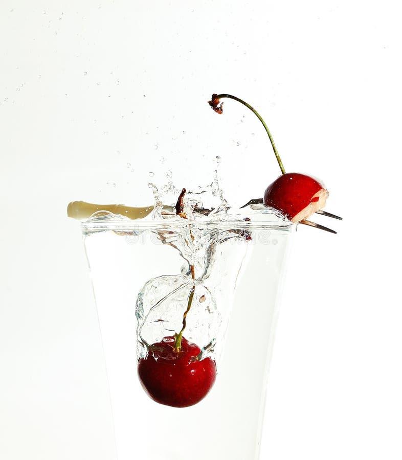 Cherries splash stock photo