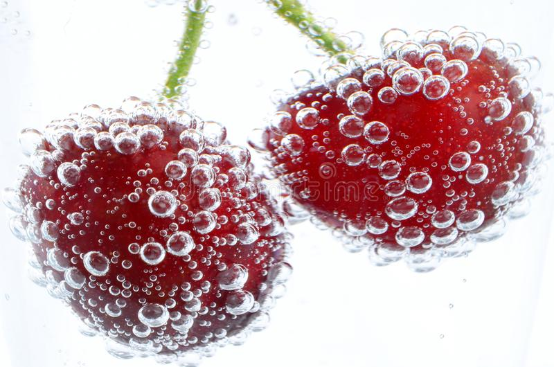 Cherries underwater royalty free stock photo