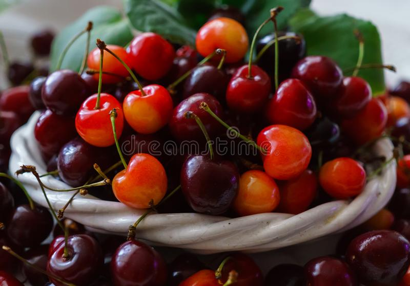 Cherries on wooden table with water drops macro background stock image