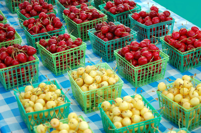 Cherry Baskets. Baskets of ripe cherries for sale at a farmer's market royalty free stock photos