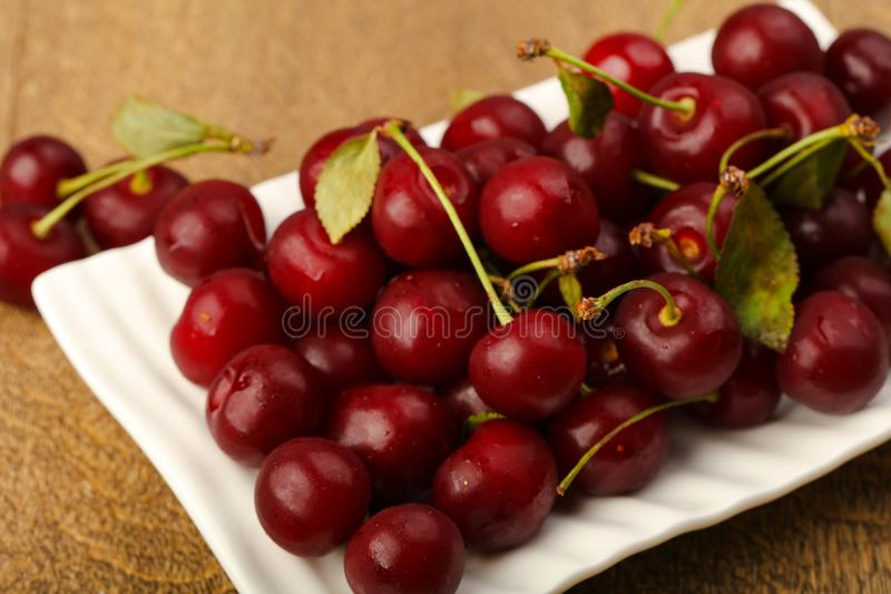 Cherry berries in the bowl stock images