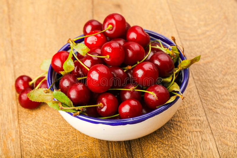 Cherry berries in the bowl royalty free stock photos