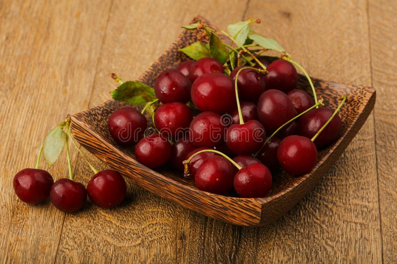 Cherry berries in the bowl royalty free stock photography