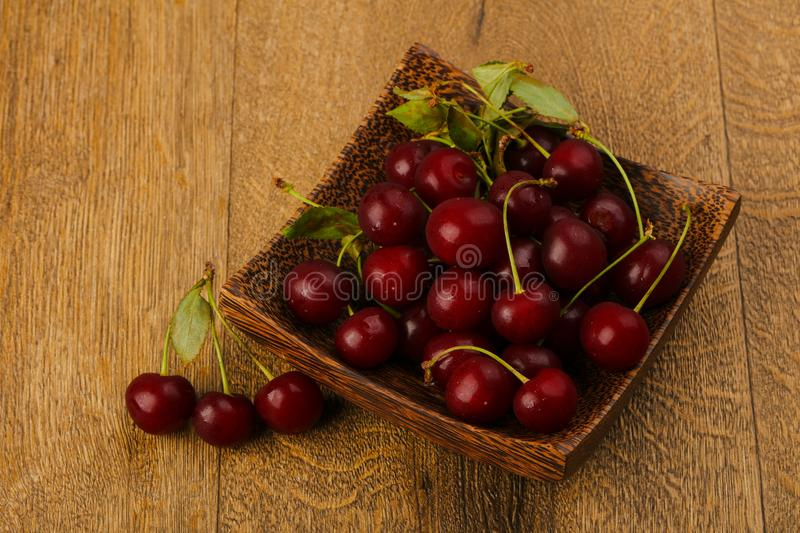 Cherry berries in the bowl royalty free stock images