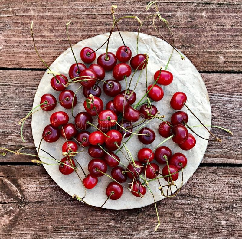 Cherry berries in rustic style stock image