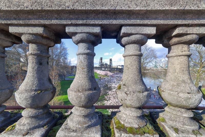 Cherry Blossom Trees Through the Stone Baluster. View of Cherry Blossoms Trees through the stone baluster on Burnside Bridge in Portland Oregon during Spring royalty free stock photo