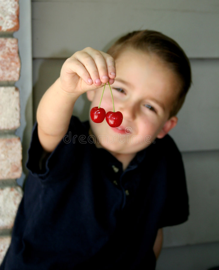 Cherry boy blur 3 royalty free stock image
