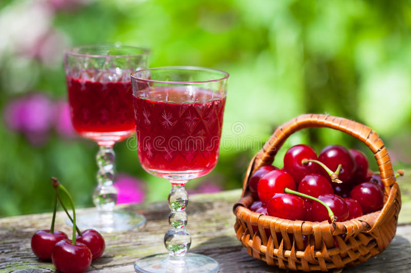 Cherry brandy and ripe berries stock photos