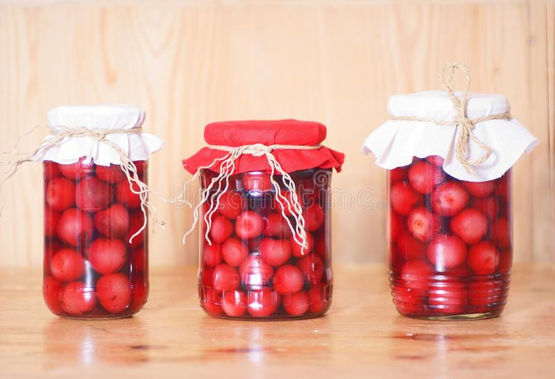 Cherry compote. In glass jar, studio shot royalty free stock photos