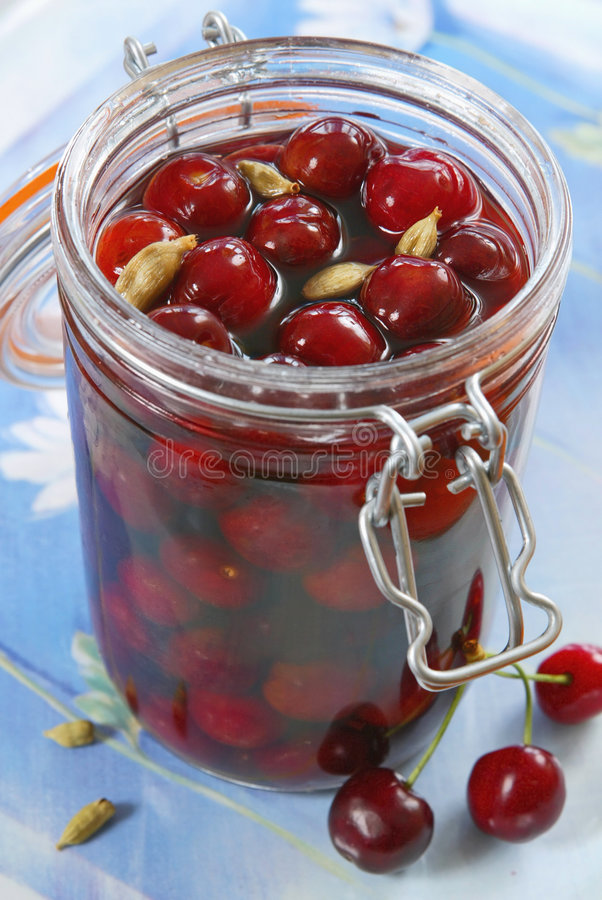 Cherry compote. In glass jar stock photos